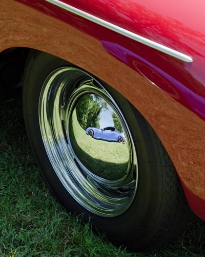 New Porsche reflected in 356 wheel