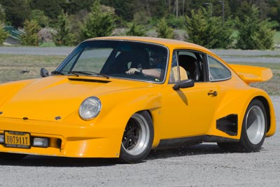 Photo of Rex McClure's yellow outlaw 911 at the autocross