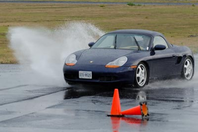 Photo of Steve Garstang's Boxster kicking up a spray of water