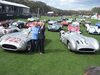 Photo of Stirling Moss and his race cars