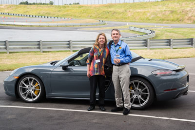 photo of Sherry & Jim with a 718 Boxster S at PEC Atlanta