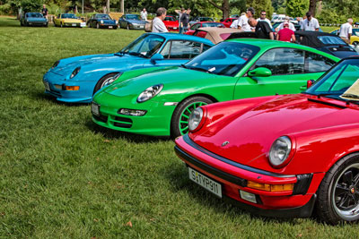 photo of blue, green, and red Porsches at RPM