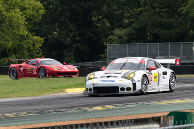 photo of Porsche #911 ahead of Ferrari #62 at Oak Tree